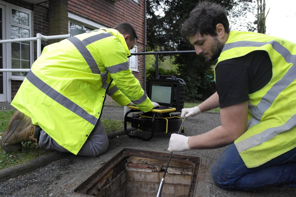 Drainage inspection engineers at a manhole